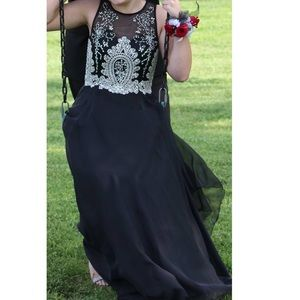 Worn once, black and silver rinestone prom dress.